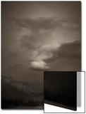 View at Dusk of Mountains with Storm Clouds Surrounding at Vermillion Lakes in Banff, Canada Poster by Keith Barraclough