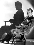 English Actor Laurence Olivier (1907-1989) Seated on a Chair's Director C. 1939 Photo