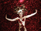 Woman Sprawled Out on Bed of Roses Covering Her Body Oscar 1999 Photo