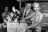 French Actor Yves Montand, American Actress Marilyn Monroe and a Birthday Cake Photo