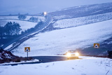A Motorist Drives Through a Wintry Landscape on the B4520 Photographic Print by Graham Lawrence