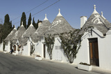 Row of 18th Century Trulli Houses in the Rione Monte District, Alberobello, Apulia, Italy Photographic Print by Stuart Forster
