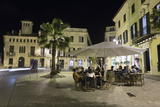 Cafe Scene at Night in the Old Town, Placa Del Princep, Mahon, Menorca, Balearic Islands, Spain Photographic Print by Stuart Black