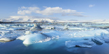 Panorama of Mountains and Icebergs Locked in the Frozen Water Photographic Print by Neale Clark