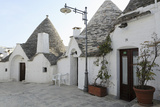 Cone-Shaped Trulli Houses, in the Rione Monte District of Alberobello, in Apulia, Italy Photographic Print by Stuart Forster