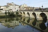 A Roman Bridge, Built in the Reign of the Emperor Tiberius, Spans the River Vidourle at Sommieres Photographic Print by Stuart Forster