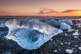 Broken Ice from Washed Up Icebergs on Jokulsarlon Black Beach at Sunset Photographic Print by Neale Clark