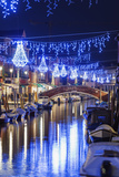 Christmas Decorations Reflected in a Canal, Murano, Venice, Veneto, Italy Photographic Print by Christian Kober