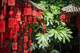 Red Wooden Buddhist Good Luck Charms and Tropical Vegetation, Hangzhou, Zhejiang, China Photographic Print by Andreas Brandl