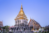 Elephant Sculptures on the Chedi Chang Lom and the Main Bot at the Temple of Wat Chiang Man Photographic Print by Alex Robinson