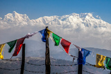 Colored Prayer Flags Flutter in Front of the Majestic Kanchenjunga Photographic Print by Roberto Moiola