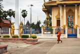 Monk Walking Past Decorative Temple at Wat Pachhaa Photographic Print by Lynn Gail