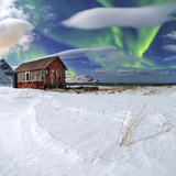 Northern Lights (Aurora Borealis) over an Abandoned Log Cabin Surrounded by Snow Photographic Print by Roberto Moiola