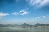 Qiantang River, Hills and High Rises of Hangzhou, Zhejiang, China Photographic Print by Andreas Brandl