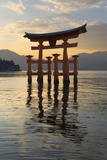 The Floating Miyajima Torii Gate of Itsukushima Shrine at Sunset Photographic Print by Stuart Black