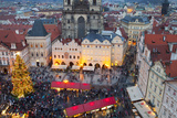 Overview of the Christmas Market and the Church of Our Lady of Tyn on the Old Town Square Photographic Print by Miles Ertman