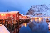 The Rorbu, the Norwegian Red Houses Built on Stilts in the Bay of Reine in the Lofoten Islands Photographic Print by Roberto Moiola