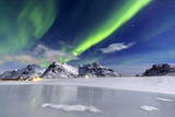 Northern Lights (Aurora Borealis) Illuminate the Sky and the Snowy Peaks Photographic Print by Roberto Moiola