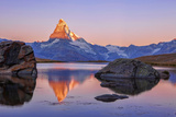 Pink Sky at Sunrise on the Matterhorn Reflected in Stellisee Photographic Print by Roberto Moiola