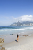 A 20-25 Year Old Young Brazilian Woman on Ipanema Beach with the Morro Dois Irmaos Hills Photographic Print by Alex Robinson
