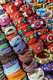 Detail of Bracelets and Rings at the Tibetan Market in Wednesday Flea Market in Anjuna, Goa, India Photographic Print by Yadid Levy
