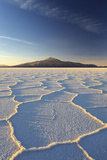 An Andean Volcano Rises Above the Salar De Uyuni Photographic Print by Roberto Moiola