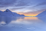 The Colors of Dawn Invading the Smooth Surface of Lago Bianco Exceptionally Icy Photographic Print by Roberto Moiola