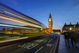 Doubledecker Bus Runs Towards Big Ben (Elizabeth Tower) Photographic Print by Roberto Moiola