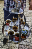 Young Man Holding a Tray with Coffee, Tea and Water in Old City, Jerusalem, Israel, Middle East Fotodruck von Yadid Levy