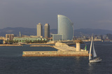 Yacht Sails Past La Barceloneta and the Waterfront Photographic Print by Eleanor Scriven