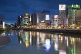 Buildings Along Hakata River at Dusk, Fukuoka, Kyushu, Japan Photographic Print by Ian Trower