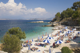 Beach Crowded with Holidaymakers, Kassiopi, Corfu, Ionian Islands, Greek Islands, Greece, Europe Photographic Print by Ruth Tomlinson