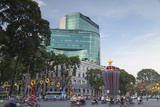 Traffic Passing Diamond Plaza, Ho Chi Minh City, Vietnam, Indochina, Southeast Asia, Asia Photographic Print by Ian Trower