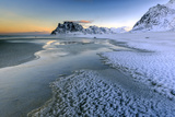 Dawn Illuminates the Beach Covered with Frozen Snow in the Cold Sea of Uttakleiv Photographic Print by Roberto Moiola