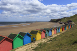 Children Kick Football Near Colourful Beach Huts Above West Cliff Beach Photographic Print by Eleanor Scriven