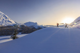 Hikers Venturing over the Frozen Lakes of the Engadine Where You Can Enjoy an Exceptional View Photographic Print by Roberto Moiola