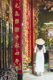 Woman Wearing Ao Dai Dress at Phuoc an Hoi Quan Pagoda, Cholon, Ho Chi Minh City, Vietnam Photographic Print by Ian Trower
