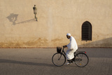 Muslim Man Dressed in White on Bicycle in Old Quarter, Medina, Marrakech, Morocco Photographic Print by Stephen Studd