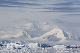 Snow-Covered Mountains Line the Ice Floes in Penola Strait, Antarctica, Polar Regions Photographic Print by Michael Nolan