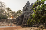 Bicycle Going Through the South Gate in Angkor Thom at Sunrise, Angkor, Siem Reap, Cambodia Fotografisk trykk av Michael Nolan