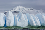 Wind and Water Sculpted Iceberg in Orne Harbor, Antarctica, Polar Regions Photographic Print by Michael Nolan