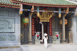 Woman Wearing Ao Dai Dress at Nghia an Hoi Quan Pagoda, Cholon, Ho Chi Minh City, Vietnam Photographic Print by Ian Trower