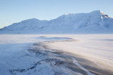 Sunrise, Hiorthfjellet Mountain and Adventtoppen Mountain across Adventdalen, Spitsbergen Photographic Print by Stephen Studd