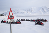 Snow Mobile Traffic Sign in Front of Snow Mobiles Photographic Print by Stephen Studd