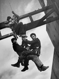 Relief Workers Hanging from Cable in Front of a Giant Beam During the Construction of Fort Peck Dam Metal Print by Margaret Bourke-White