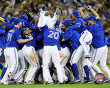 The Toronto Blue Jays celebrate winning Game 5 of the 2015 American League Division Series Photo