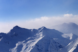 Panorama of Snowy Mountains in Early Morning Fog Photographic Print by  BSANI