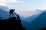 Teamwork Couple Climbing Helping Hand Photographic Print by  blas