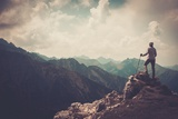 Woman Hiker on a Top of a Mountain Photographic Print by NejroN Photo