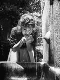 Actress Sophia Loren Drinking Water from Spigot Metal Print by Alfred Eisenstaedt